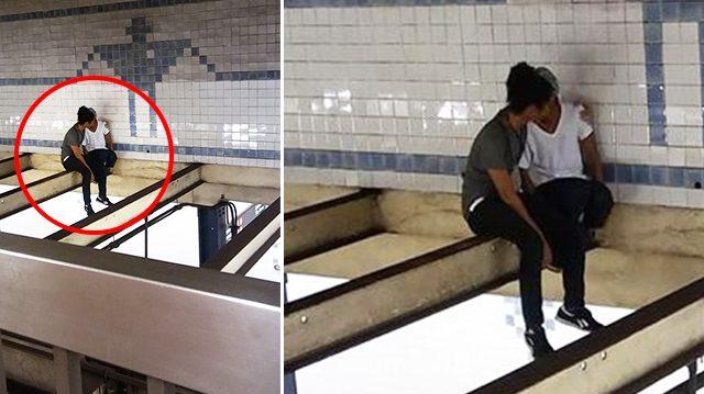 Un homme risque sa vie pour parler à une fille de suicidaire, 6 m au-dessus d'un quai de métro