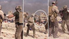 Alors que l'organisation terroriste État Islamique ouvre le feu, un ancien soldat court entre les balles pour sauver une enfant irakienne